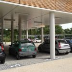 Stationnements gravier et places accessibles PMR